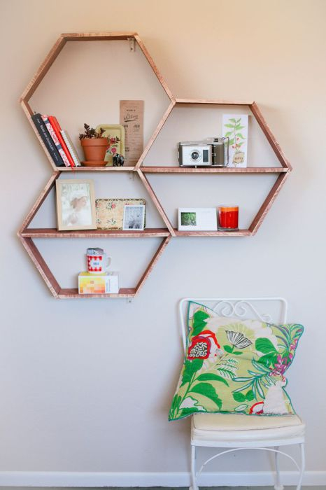 Wooden shelves in form of hexagons
